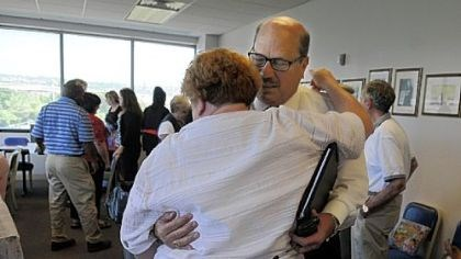 Hug Leah Lipner, left, gives John Tarka, president of the Pittsburgh Federation of Teachers, a congratulatory hug Monday.