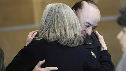 Hugging after news conference Lt. Michael Scott receives a hug from Beth Pittinger, director of the Citizen Police Review Board, after a news conference yesterday afternoon about the officers' shooting.