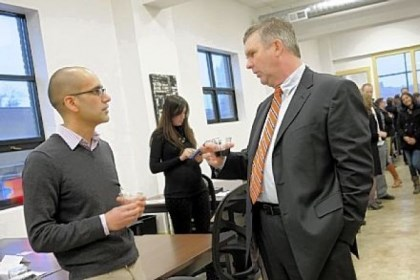 Hustle Den Anup Aryal, left, with the startup Open Curriculum, talks with Tim Devlin, a program director at Allegheny Intermediate Unit, at the grand opening of the Hustle Den Wednesday in East Liberty.