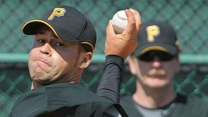 Ian Snell and Joe Kerrigan Pirates pitching coach Joe Kerrigan in the background keeps a close eye on pitcher Ian Snell.