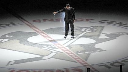 Ice Mario Lemeiux pours water from the melted ice surface of the Mellon Arena onto center ice of the new Consol Energy Center before the season opening game against the Flyers.