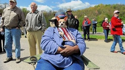 "Ilene Hightower Ilene Hightower of Penn Hills holds her chihuahua, BonBon, while listening to a speaker at the Tea Party Express ""Restoring the American Dream"" tour stop at North Boundary Park in Cranberry on Friday."