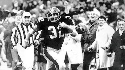 "Immaculate Reception Franco Harris gives a goodbye look to an Oakland Raiders defender as he streaks down the sidelines for the winning touchdown after his ""Immaculate Reception"" in the 1972 AFC playoffs."