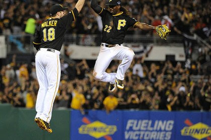 infielder Neil Walker Pirates outfielder Andrew McCutchen and infielder Neil Walker celebrate after the Pirates take a 2-1 lead in the NLDS series.