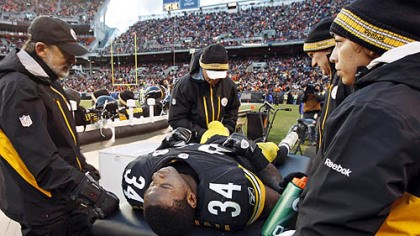 Injury examined Rashard Mendenhall is examined on the sideline after an injury in the first half of the game against the Cleveland Browns.