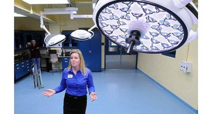 Inside the Animal Care Center Ginger Takle, director of animal health, describes the treatment room during a tour of the new Animal Care Center at the zoo.
