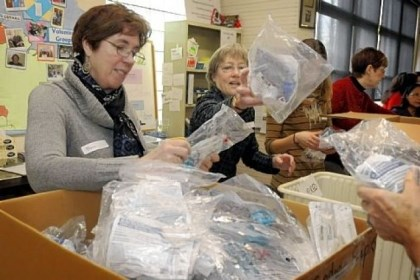 International Women's Association of Pittsburgh Sharon Deacon, left, and Susie Williams, both of the International Women's Association of Pittsburgh, sort through medical supplies at Global Links in Garfield.