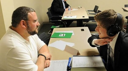 interview2 Bryan Baer, left, general manager of Budd Baer Auto, interviews Ryan Rettger, 17, of Bethel Park during a mock interview at Allegheny Intermediate Unit in Homestead.