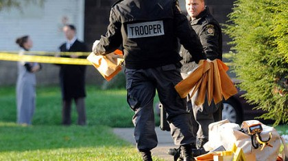 Investigators at shooting scene Forensic investigators with the state police gather evidence at the scene of a shooting at an off-campus apartment building by California University of Pennyslvania.