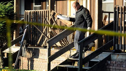 Investigators gather evidence Forensic investigators with the state police gather evi