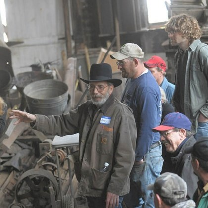 Iron auction Marty Zuegar, center, runs an auction at the 25th annual Hammer-In at the W.A. Young & Sons Foundry and Machine Shop in Rices Landing, Greene County.