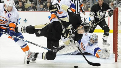 Islanders 5, Penguins 3 Islanders Evgeni Nabokov makes a diving save on Pascal Dupuis in the third period.