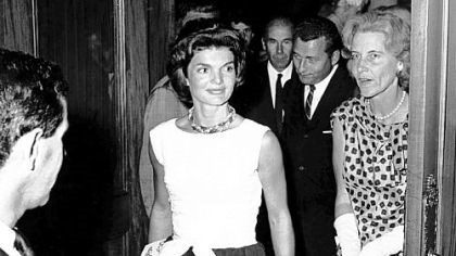 "Jacqueline Kennedy and her friend Rachel ""Bunny"" Mellon Jacqueline Kennedy and her friend Rachel ""Bunny"" Mellon step into the lobby of the Colonial Theatre in Boston on Aug. 17, 1961, during intermission of Noel Coward's ""Sail Away."""