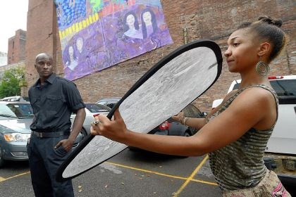 Jamar Scales and Wadria Taylor Wadria Taylor holds a light reflector for a photographer as he shoots model Jamar Scales, left, during the pop-up photo shoot along the Boulevard of the Allies, Downtown.