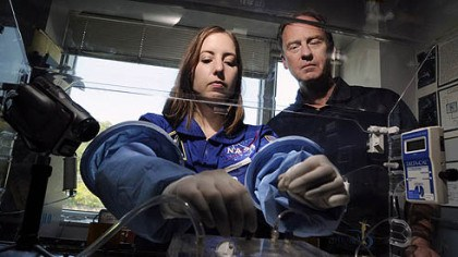James Burgess, Jennifer Hayden Jennifer Hayden, a biomedical engineering doctoral student at Carnegie Mellon, and neurosurgeon James Burgess work with the Aqueous Immersion Surgical System prototype to be tested under zero gravity through NASA.