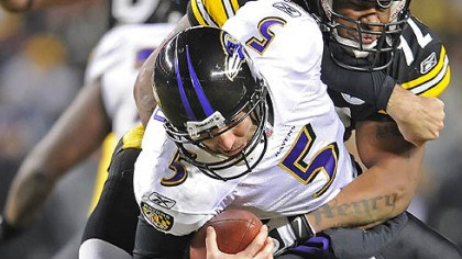James Harrison and Joe Flacco The Steelers' James Harrison sacks Ravens quarterback Joe Flacco.