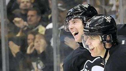 James Neal and Evgeni Malkin James Neal congratulates teammate Evgeni Malkin after scoring the winning goal in overtime against the Capitals Sunday at Consol Energy Center.