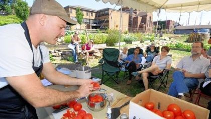 Jamie Moore Jamie Moore, Eat'n Park's director of sourcing and sustainability, demonstrates canning tomatoes at the Braddock Community Garden last month.