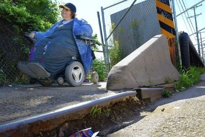 Janet Ebans, Kenmawr Bridge Janet Ebans of Glen Hazel cannot even get to the Kenmawr Bridge on South Braddock Avenue in Swissvale because of the rusted metal edge to the sidewalk and no ramp to lead to the deck.