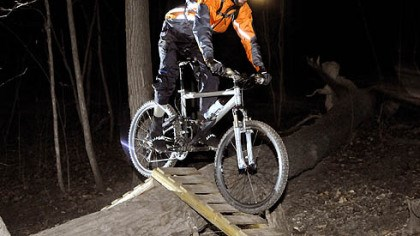 Jared Musser, a civil engineer Jared Musser, 26, a civil engineer, pedals over a ramp on the Nature Trail in Frick Park. He began night riding in 2002, when he bought his first headlight.