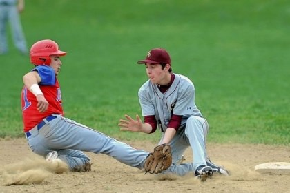 Jayhawks baseball Jeannette's Zack Altieri slides back to second base while Steel Valley's Sean McShane awaits the throw.