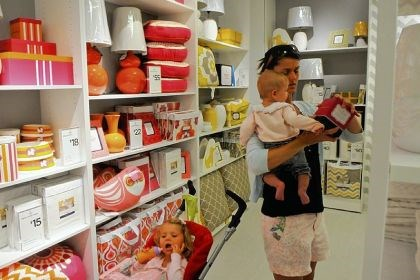 jcp1 Kerry Feierabend of Moon shops in the new home department at the J.C. Penney store at the Mall at Robinson with her children Katherine, 2 (in the stroller) and Quinn, 5 months.
