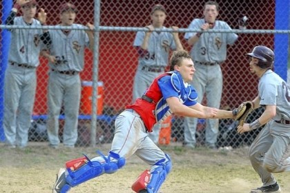 Jeannette baseball Jeannette catcher Michael Wise awaits the throw while Steel Valley's Pat Jobes digs for home during a game last week.