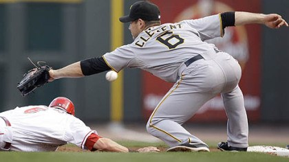 Jeff Clement and Drew Stubbs Pirates first baseman Jeff Clement misses a pickoff throw from pitcher Ross Ohlendorf as the Reds' Drew Stubbs dives safely back to first base in the second inning. Clement was charged with an error allowing Stubbs to advance to second.