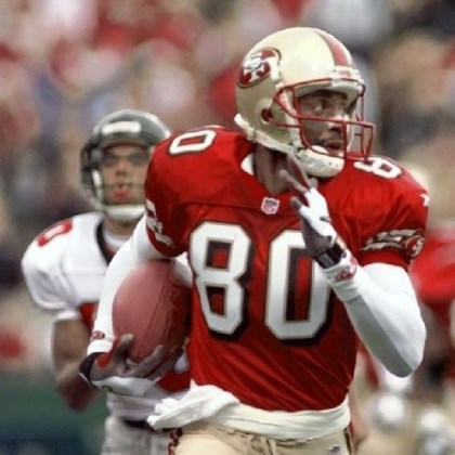 Jerry Rice runs for a touchdown in 1998 Jerry Rice runs for a touchdown in 1998.