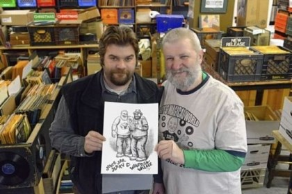 Jerry Weber and his son, Willie Jerry Weber and his son, Willie, left, of Jerry's Records in Squirrel Hill, with a drawing of them by Robert Crumb. The Webers plan to sell T-shirts featuring the drawing in the early spring.