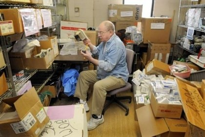 Jim Carr Jim Carr of Shaler, a retired phone company technician, checks and fixes blood pressure monitors in a back room of Global Links in Garfield. Mr. Carr volunteers at Global Links four to six hours a week.