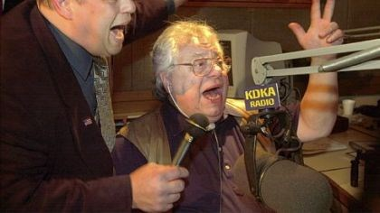 Jimmy Sapienza and John Cigna Jimmy Sapienza, left, of the band Five Guys Named Moe sings with John Cigna during Mr. Cigna's last show on KDKA Radio on Dec. 21, 2001.