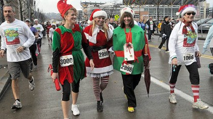 Jingling in the rain Left to right: Susan Grimm, Anastasia Hoydich and Betsy Scheidemantel brought holiday cheer to the Arthritis Foundation's Jingle Bell Run/Walk held Saturday morning on Pittsburgh's North Side.
