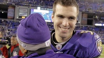 Joe Flacco Baltimore Ravens quarterback Joe Flacco, right, gets a hug from an unidentified member of the Ravens staff.