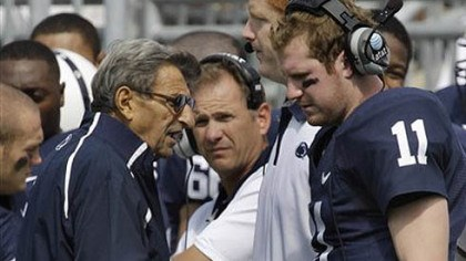 Joe Paterno Penn State head coach Joe Paterno, left, talks with quarterback Matt McGloin on the sidelines during the first quarter of today's game against Eastern Michigan in State College.