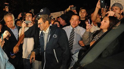 Joe Paterno A large group of students and others surround Penn State football head coach Joe Paterno at his home.