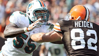 Joey Porter Miami Dolphins linebacker Joey Porter is blocked by the Browns' Steve Heiden yesterday in Cleveland.