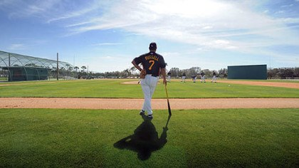 John Russell Pirates manager John Russell watches pitchers during workouts at Pirate City.