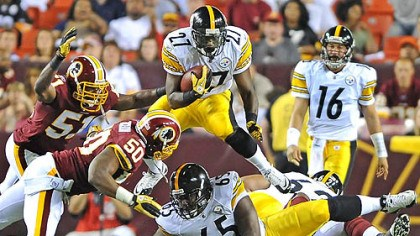 Jonathan Dwyer Pittsburgh Steelers Jonathan Dwyer leaps over the Redskins defense picking up a first down in the fourth quarter of Friday's game.