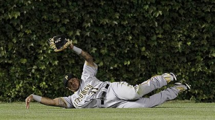 Jose Tabata Pirates left fielder Jose Tabata makes a sliding catch of a fly ball by Chicago Cubs' Tyler Colvin during the fourth inning last night at Wrigley Field in Chicago.