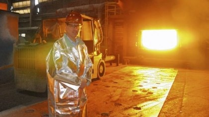 Joseph M. Mallak Hussey Copper's president and CEO, Joseph M. Mallak, near the open door of the 2,200-degree furnace used to hold 540,000 pounds of melted copper.