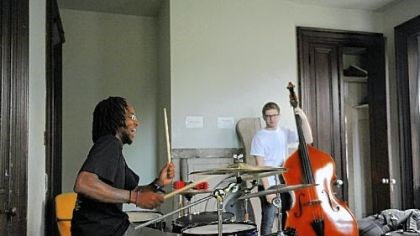 Julian Powell and Sam Harris Julian Powell, 22, of Braddock is on drums and Sam Harris, 18, of Point Breeze plays the bass. Performers earn and keep track of money as part of the outreach effort of the Center of Life.