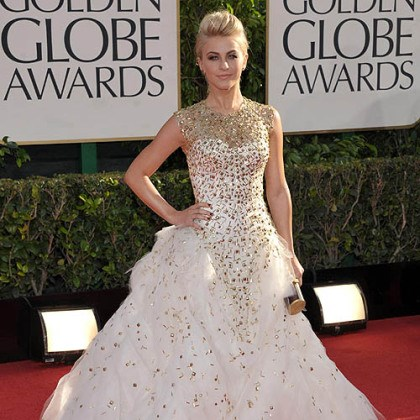 Julianne Hough on red carpet Julianne Hough's Monique Lhuillier gown featured a blush color, a full tulle bottom and gold studded detailing on the bodice