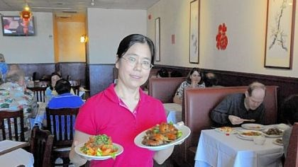 Julie Zhu Julie Zhu shows the authentic Sichuan cuisine served at China Star in the North Hills' McIntyre Square.