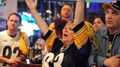 June Hough Repic - touchdown June Hough Repic raises her arms when the Steelers score.
