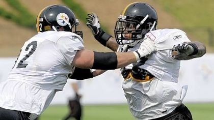 Justin Hartwig and Maurice Pouncey Steelers first-round pick Maurice Pouncey, right, goes through drills with teammate Justin Hartwig during the first day of the team's 2010 training camp in Latrobe last month.