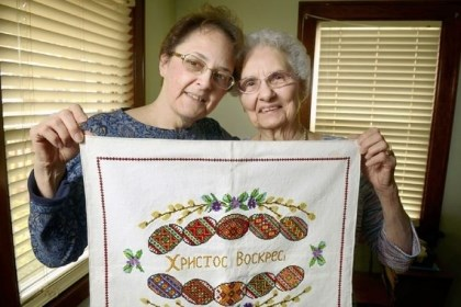 Justine Woytovich and her mother, Stella Justine Woytovich and her mother, Stella, 86, of Baden hold the hand-stitched cloth they use to cover a basket of Easter food they prepare each year.