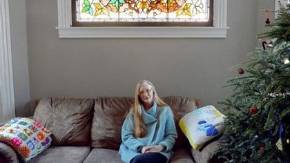 Kasey Connors Kasey Connors of Wilkinsburg with a stained-glass window that was uncovered in a wall in one of her houses. She will speak about buying and restoring properties at 10 a.m. today at the Landmarks Housing Resource Center, Wilkinsburg.