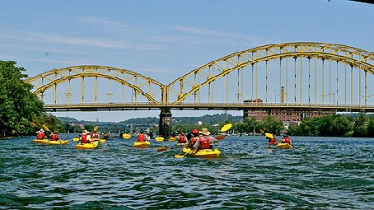 kayakers A group of kayakers explore the Three Rivers during Venture Outdoors annual Pedal, Paddle, Peduto event.