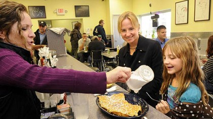 Kelly O's diners Kelly O'Connor sprinkles powdered sugar on French toast for Rachel Hardy, 8. Rachel and her mom, Tammy, of Peters, stopped in for lunch after a doctor;'s appointment. Tammy had pumpkin pancakes, claiming they were the best she has ever had.